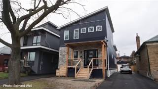 Six modular-home rooms are hoisted by crane and installed on a pre-cast foundation to create a new home in eight hours, as seen in this time-lapse video.