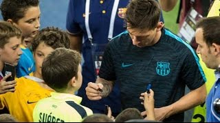 Lionel Messi signs autographs to some children happy in Tbilisi before the UEFA Super Cup 2015/2016