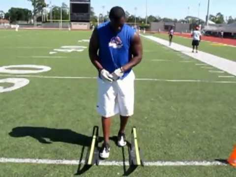 Blitz Football Camp Defensive Back Cone and Sparq Hurdle Drills Movie.wmv