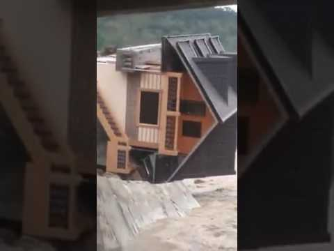 House in Bontoc, Mountain Province Philippines collapses during Typhoon Lawin/ Haima