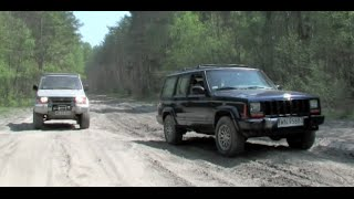 Jeep Cherokee and Mitsubishi Pajero at tanks training area - HD