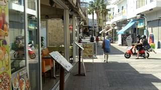 Hersonissos, Crete - Coastal strip cafe's and shops(Video of the coastal strip by the harbour in Hersonissos, Crete. This is one of a number of Hersonissos and Crete video's I've posted., 2012-06-01T09:53:50.000Z)
