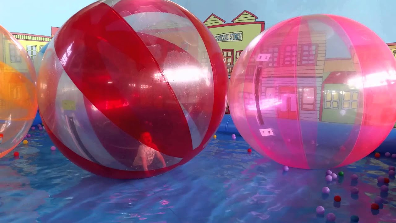 Kids having fun and playing in walking water ball Funny video