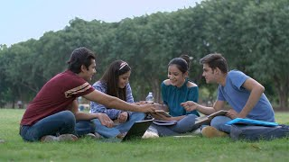 Happy Indian friends having fun together in their college life during leisure time
