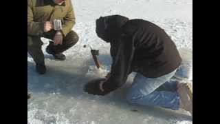 Catching a fish as BIG as me while ice fishing, reeling it in by hand.