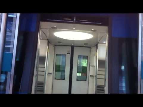 MTR AEL A Train E104-K404 departing AIR 1 to AWE