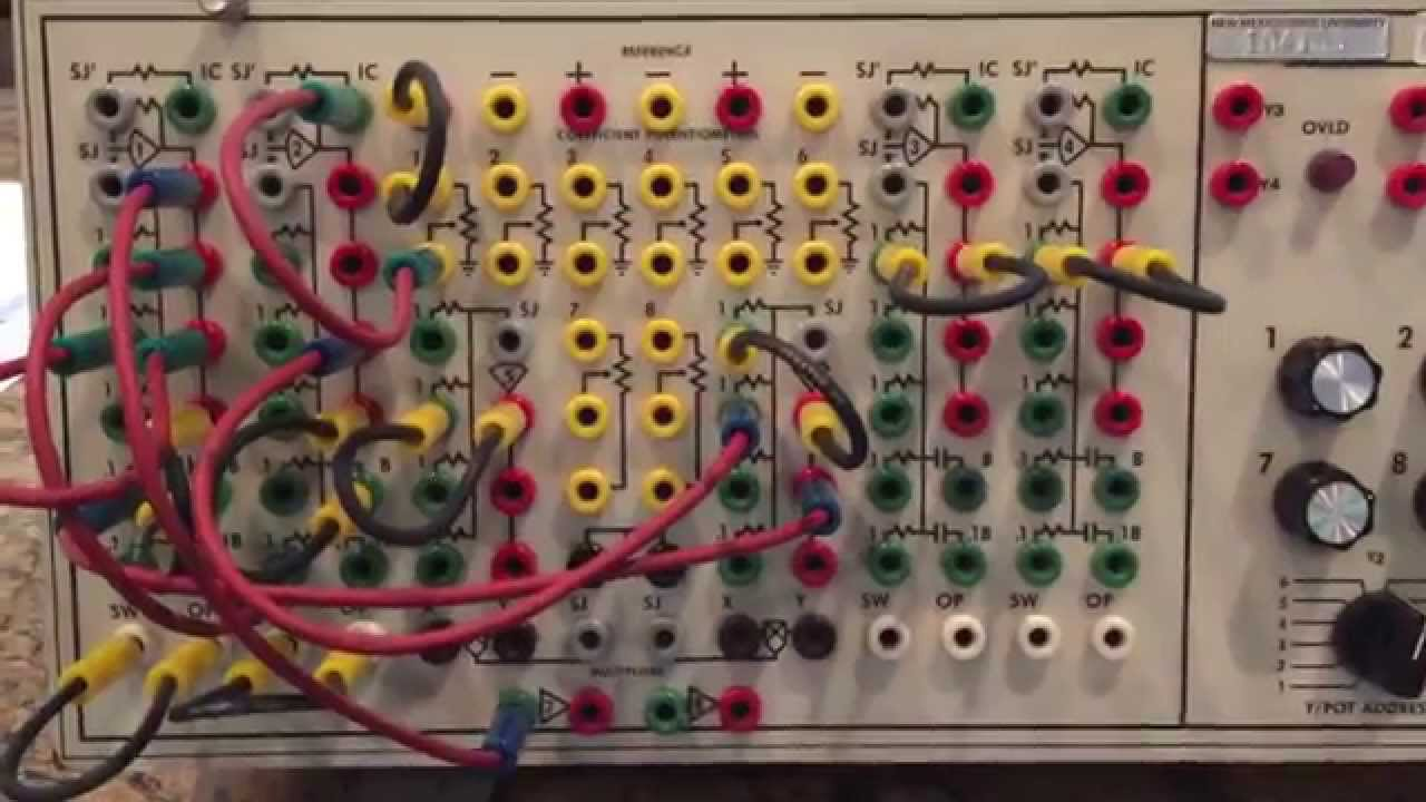 Analog computer (Comdyna GP-6) programmed to solve a simple oscillator with  damping