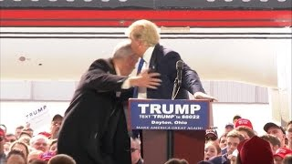 Watch: Secret Service run to Trump as protester rushes stage