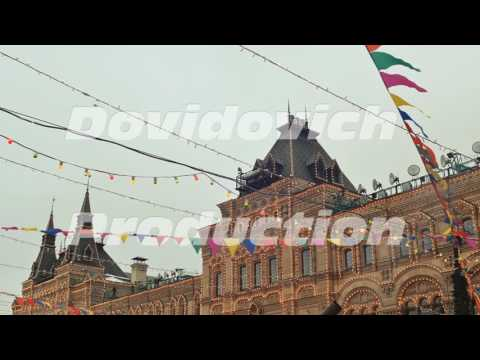 Moscow. Illumination of an architectural building for Christmas. Hanging flags on the streets of the