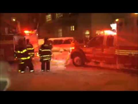 FDNY fire truck tows ambulance during blizzard