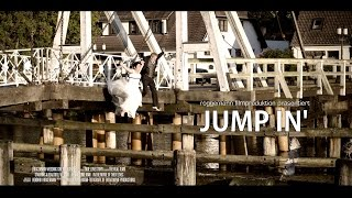 Jump in' - A couple in wedding clothes enters a bridge and jumps