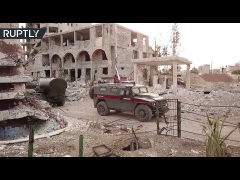 RAW: Russian military police start patrolling streets of Douma, Syria