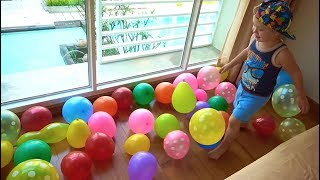 Lev and Dad pretend play with toys in colorful balls