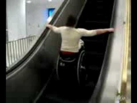 Man In Wheel Chair Falls Down Esculator  escalator