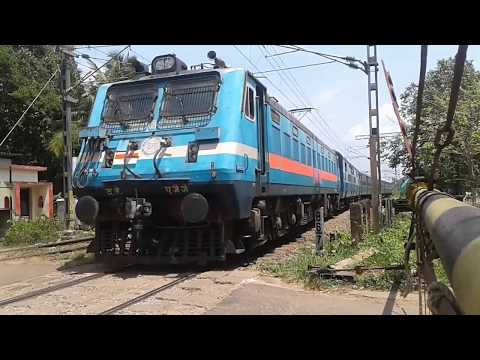Ernakulam kollam transit train crossing haripad station