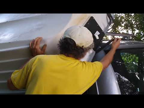 Loading A Boat Onto Roof Of Vehicle