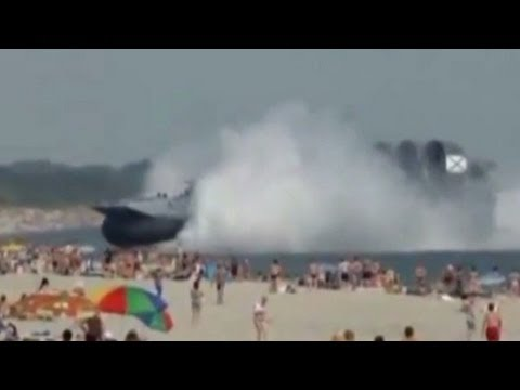 Massive hovercraft lands on beach