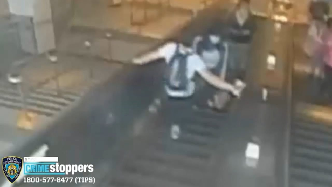 Download Search for man who kicked woman down subway escalator