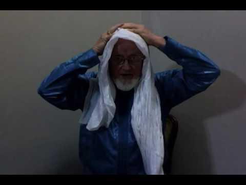 Macky ties a Tuareg turban