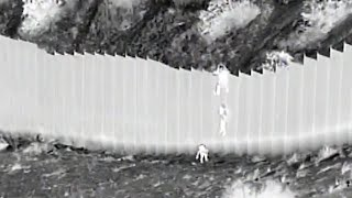 video: Two toddlers dropped from a 14ft border fence into the New Mexico desert