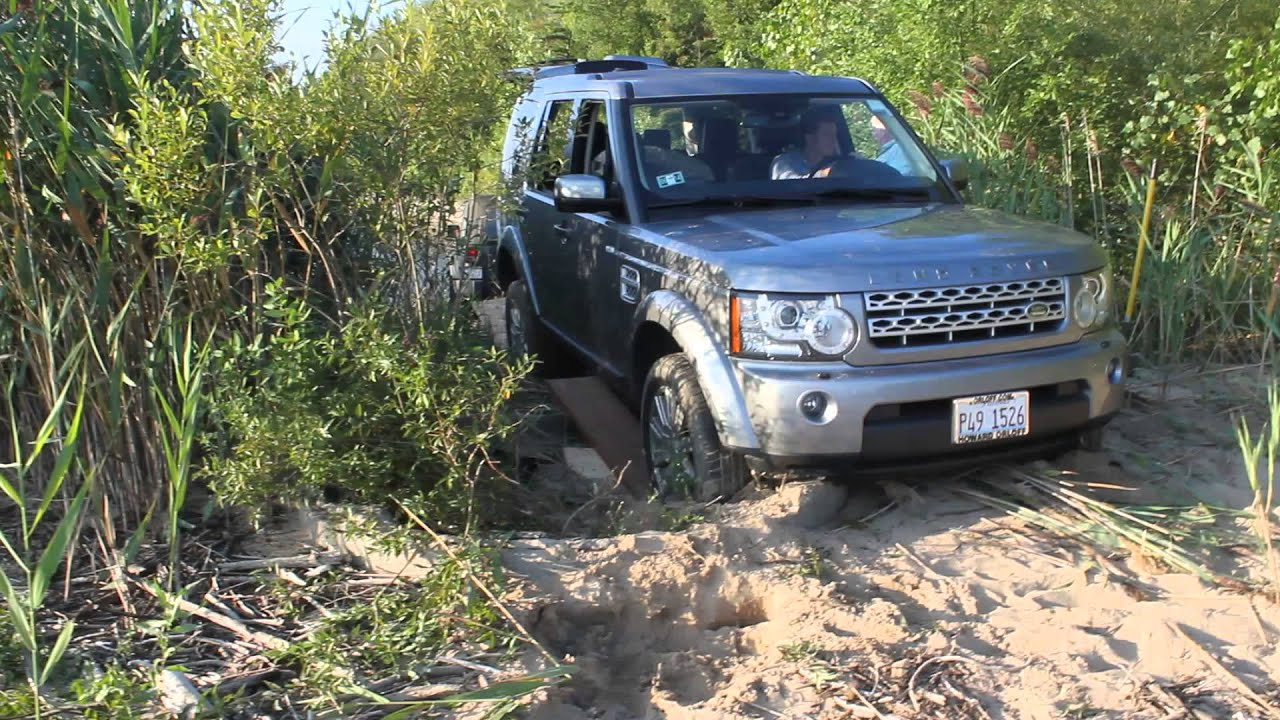 Land Rover LR4 being pulled out by Jeep Wrangler JK Lake Huron