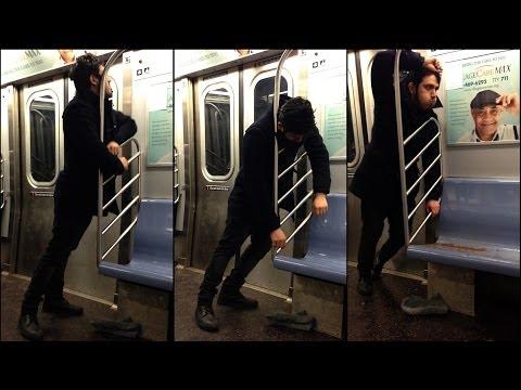 Watch This Man Vomit Epically on the Subway