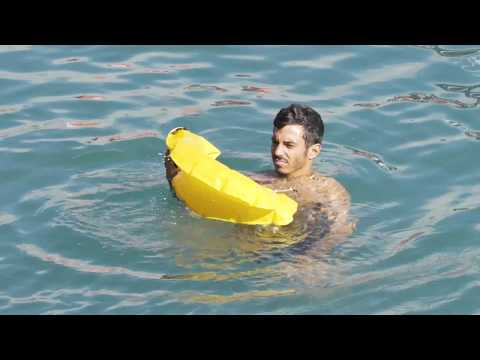 OneUp - Portable inner tube that inflates on contact with water in the shape of a life preserver. Mp3