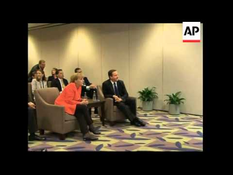 German Chancellor Merkel and UK PM Cameron watch World Cup clash