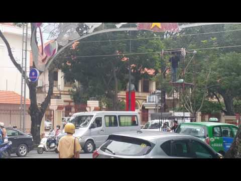 Ho Chi Minh city: safety OMG at work. Le Duan street. District 1. Vietnam