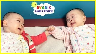 Twin babies talking to each other and holding hands! Babies laughing with Ryan's Family Review Vlog