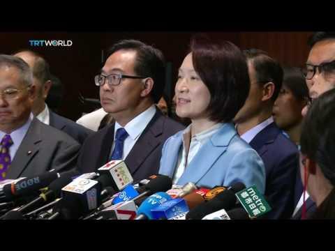 Hong Kong Politics: Lawmakers scuffle in Legislative Council