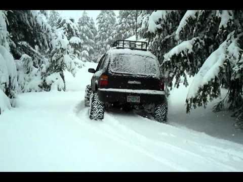 Lifted Kia sportage snow wheeling