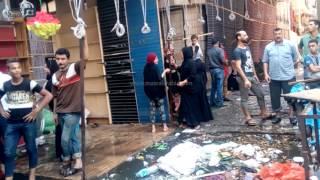 مصر العربية | أصحاب محلات حريق امبابة يزفعون اثار الحريق مخازنهم