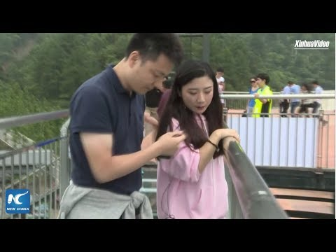Terrified tourists dragged across record-breaking glass bridge in Chongqing, China