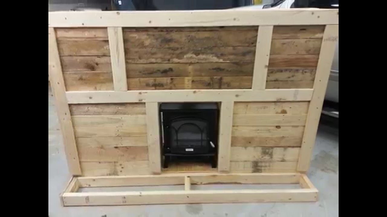 Showing how I made my homemade fireplace mantel from pallet wood. fireplace is an electric fireplace