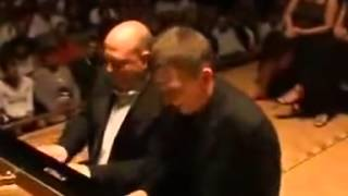 Amazing Grace Piano Duet - Who are the pianists?