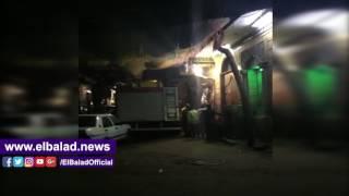 قوات الحماية المدنية تبحث عن فتاة تحت أنقاض عقار بولاق أبو العلا المنهار.. فيديو