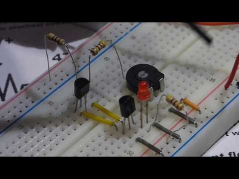 Two 2n2222 NPN transistors wired as a schmitt trigger for electronics demonstration circuit