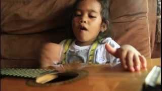 Faithlene Sianturi Playing Guitar and Singing Christmas Song in Bahasa Indonesia