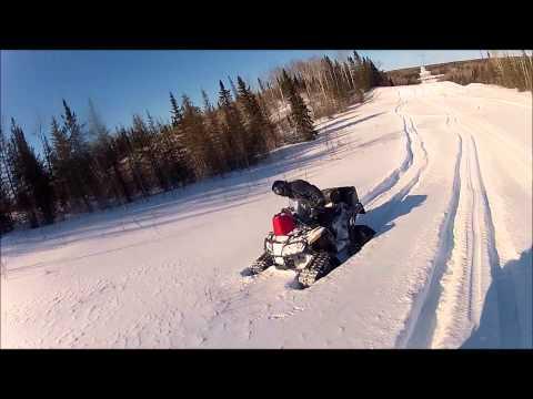 atv's-on-tracks-riding-in-deep-snow-..