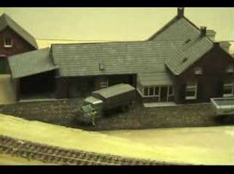 Animated scene on HO-scale model railroad layout.