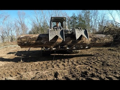 Clearing land with excavator and skidsteer
