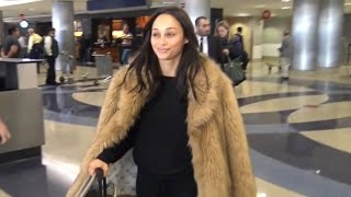 Cara Santana Sports Fur Coat Arriving Home From NYC, Keeps Wedding Date Secret