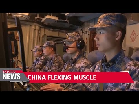 China stages major naval and air force exercises