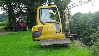 Digging Out Ditches with Komatsu Digger plus MF 4345 with digger trailer