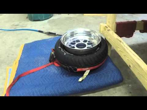 Stretching a Honda Ruckus tire onto a 12X8 inch wheel.