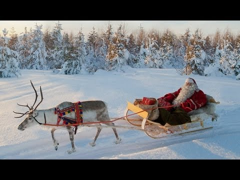 Santa Claus and Reindeer on the road - Lapland Finland Rovan