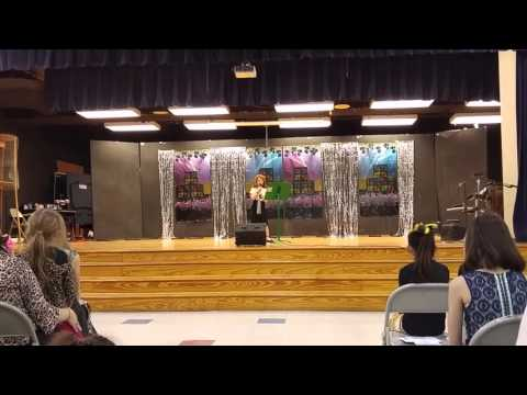Lucy's talent show , singing Let Her Go by...