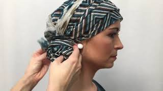Teal chemo head scarf wrapped as turban with a hair elastic