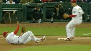 Albert Pujols slips, rolls and throws to first base for the out